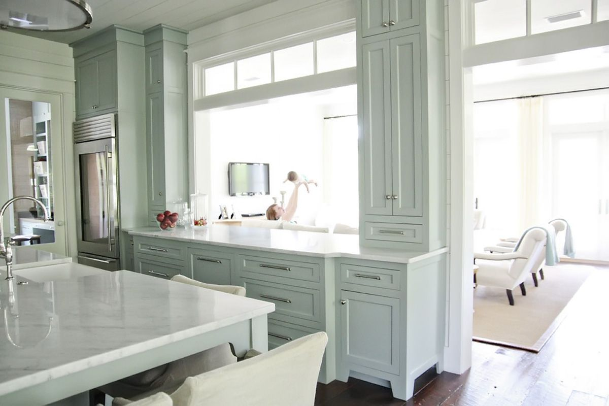 love this...I love the style of the cabinetry and the white marble ...