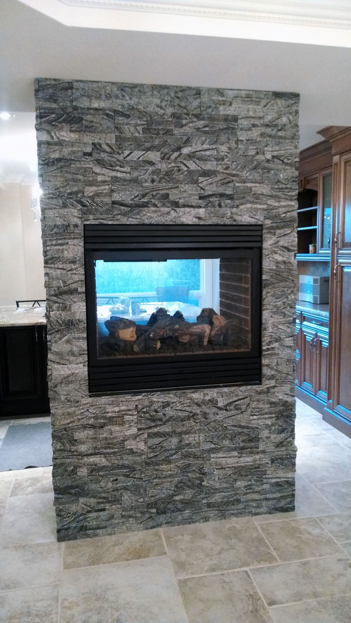 60F ErthCOVERINGS Grey Wolf 3D Double sided fireplace by Valdor Engineering.