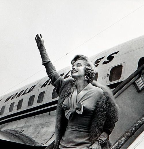 Marilyn waving after her Korea Tour, 1954