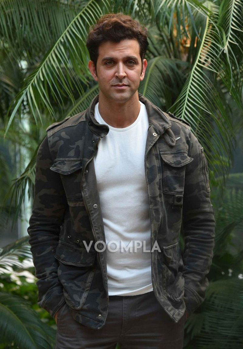 Hrithik's smart casual look in a military print jacket and white T-shirt. via Voompla.com