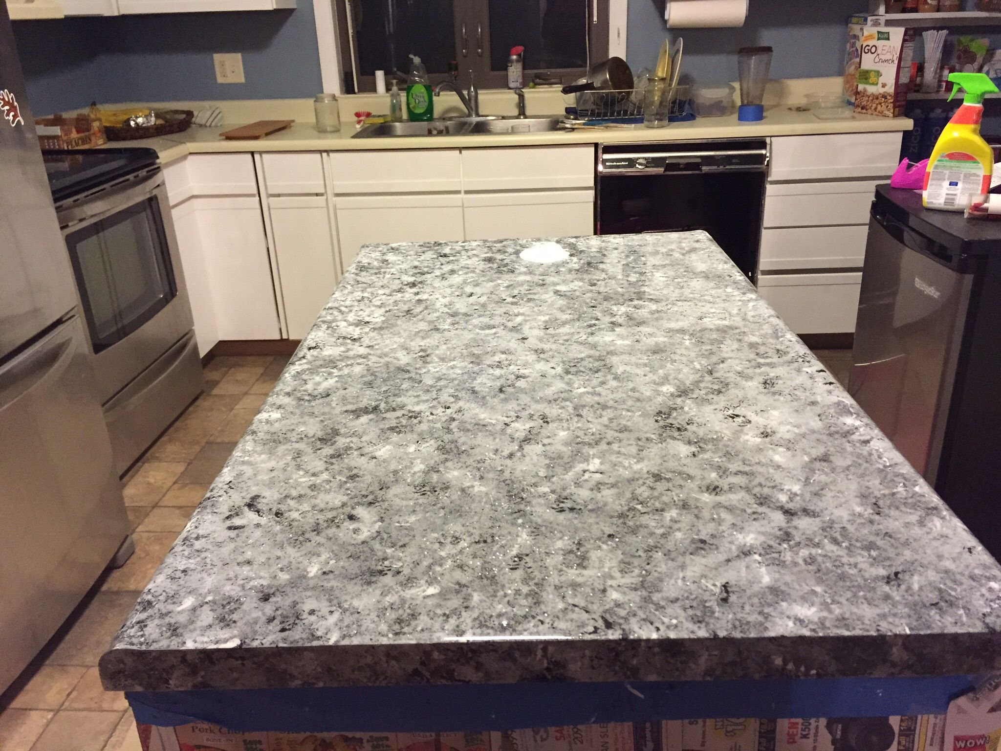 Old, ugly, laminate countertops painted to look like faux granite ...