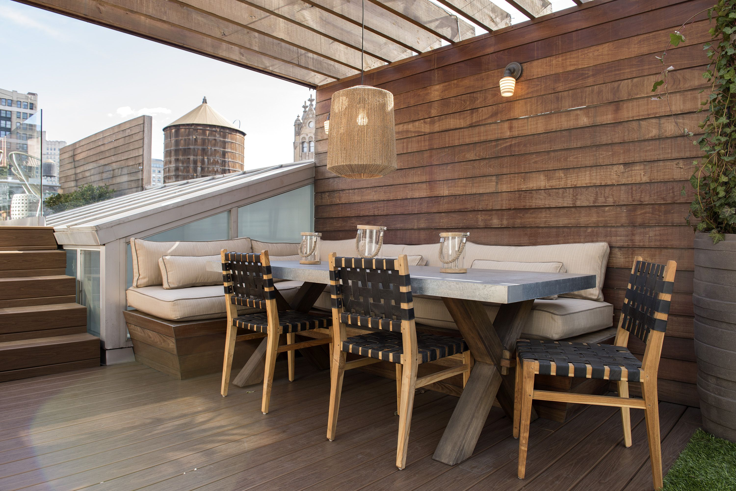 Rooftop Dining Is Made Comfortable With A Trimmed Sofa Banquette