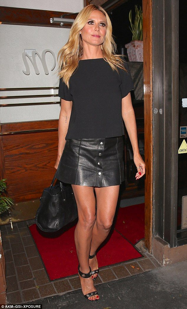 Heidi Klum Showcases Her Slender Legs In A Black Leather
