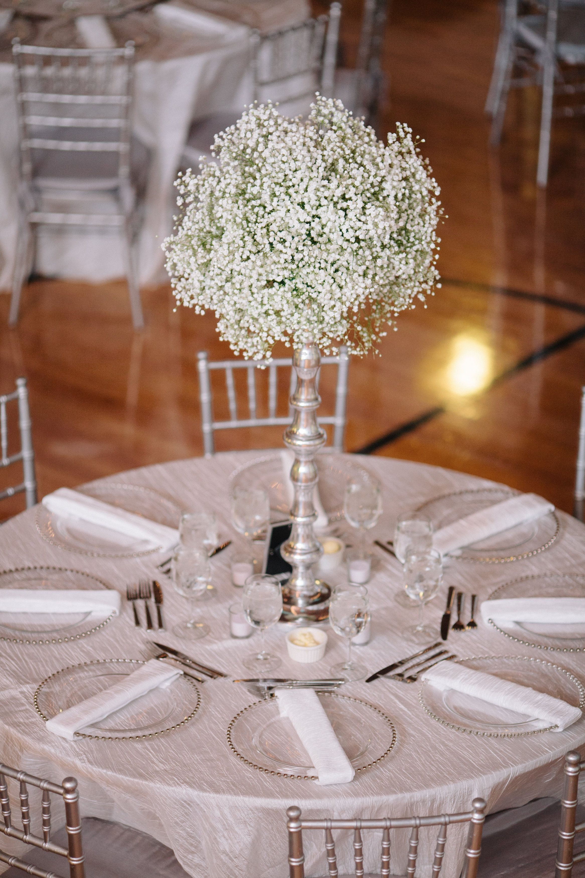 All silver and white wedding with grand babys breath as