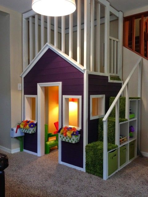 purple playhouse beside the stairs with light inside