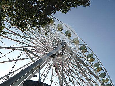 Ferris Wheel against a blue sky at a fair.