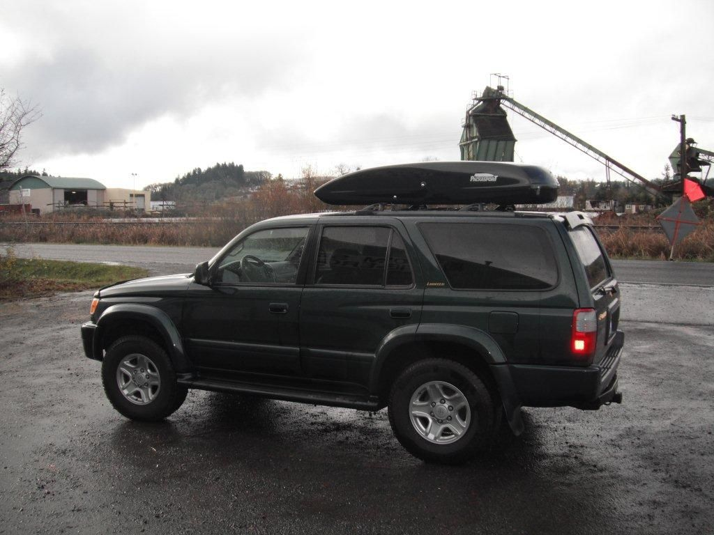 Toyota 4 Runner with a black Packasport 71ss roof top