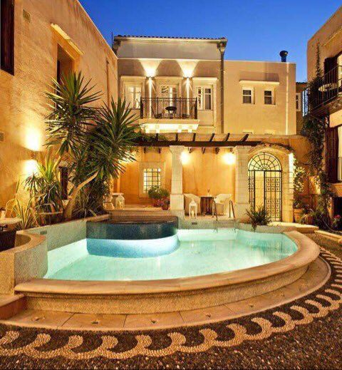 Stay At Rimondi Boutique Hotel Formed Of 2 Historic Properties Featuring An Enchanting Cobblestone Courtyard And Tropical Gardens With A Pool Jacuzzi