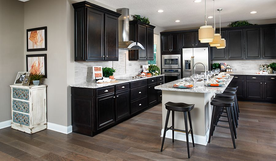 This jacksonville fl kitchen boasts dark wood cabinets for Kitchen cabinets jacksonville fl