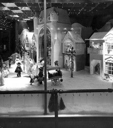 Photo of the holiday window display 'Christmas Village' at Lazarus in downtown Columbus, 1958.
