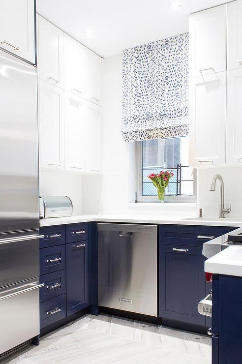 White And Blue Kitchen Features White Upper Cabinets And Blue Lower Cabinets Paired With White Quartz Countertops Home Decor Kitchen Kitchen Colors Home Decor