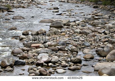 Beautiful Mountain Stream Filled With Smooth Rocks Or Stones Stock
