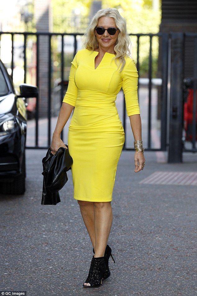 b43a7ed2a64 Yellow fever! The 54-year-old looked sensational as she slipped into a  bright yellow dress for her TV appearance