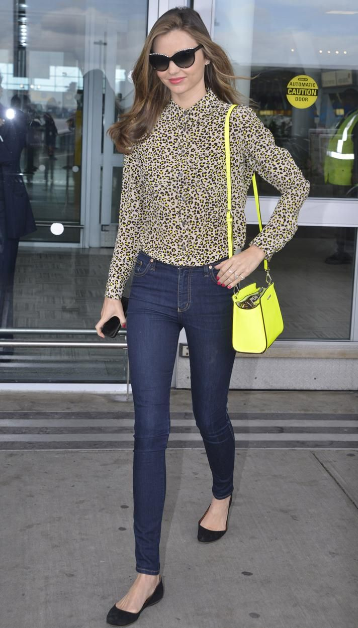 21eed7ab15b Miranda Kerr wearing a leopard print button-down shirt with sleek skinny  jeans