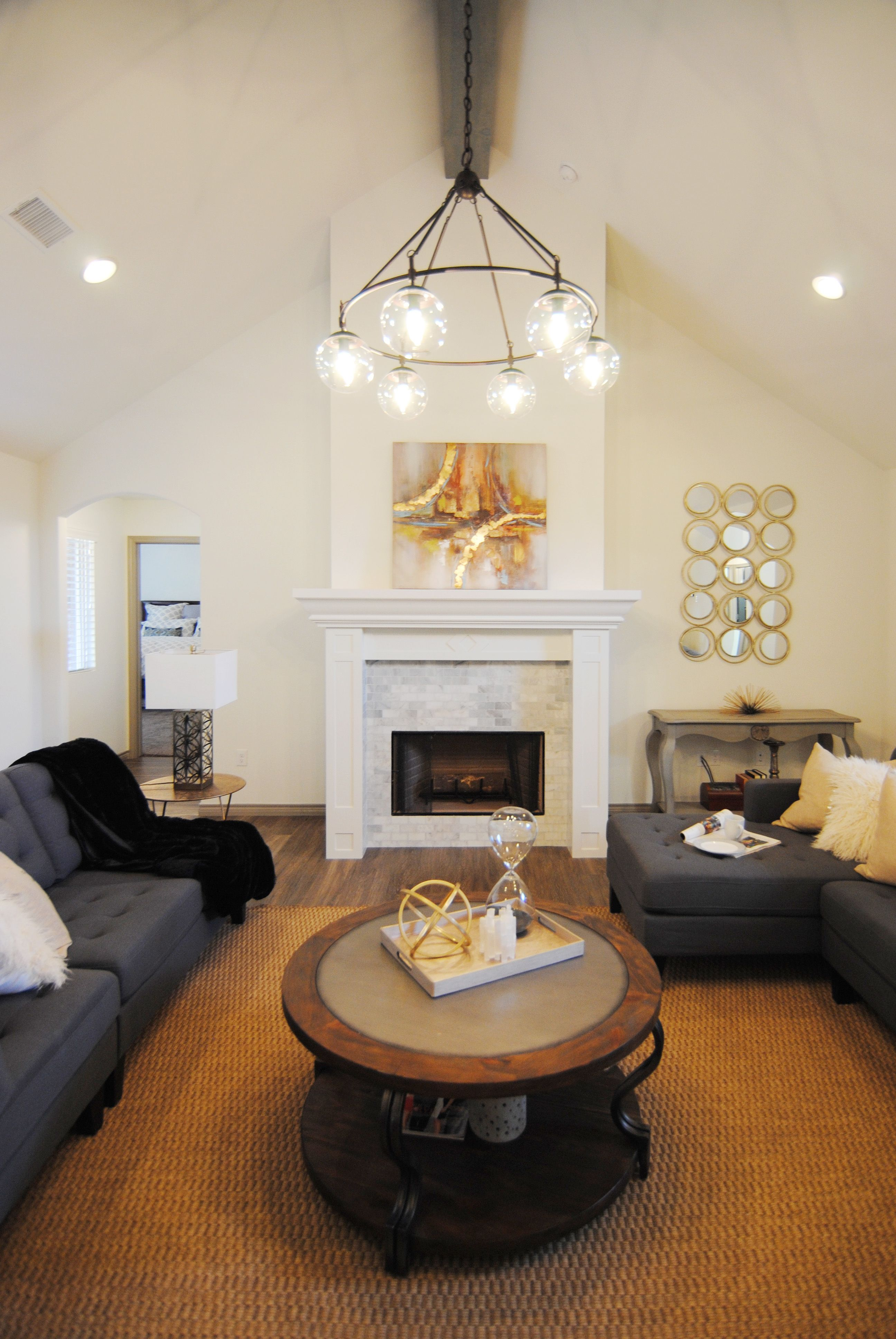 Living room by ventura homes marble fireplace marble tile fireplace chandelier