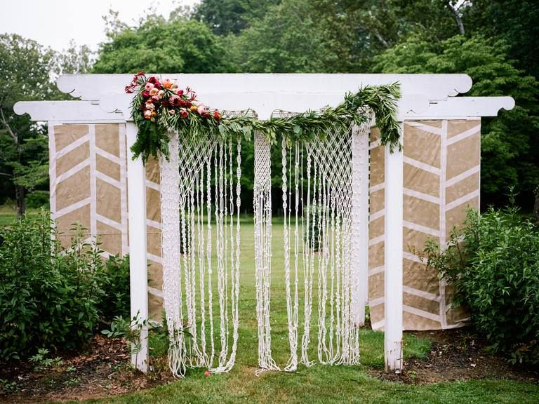 "Macramé designs can host multiple patterns in one piece, giving your guests some extra eye candy in one fantastic element. Want to dress it up a bit? String a flower garland above it for even more of a ""pop."" #adairytalewedding #weddingdecor #weddingplanning #weddingplanner #macrame"