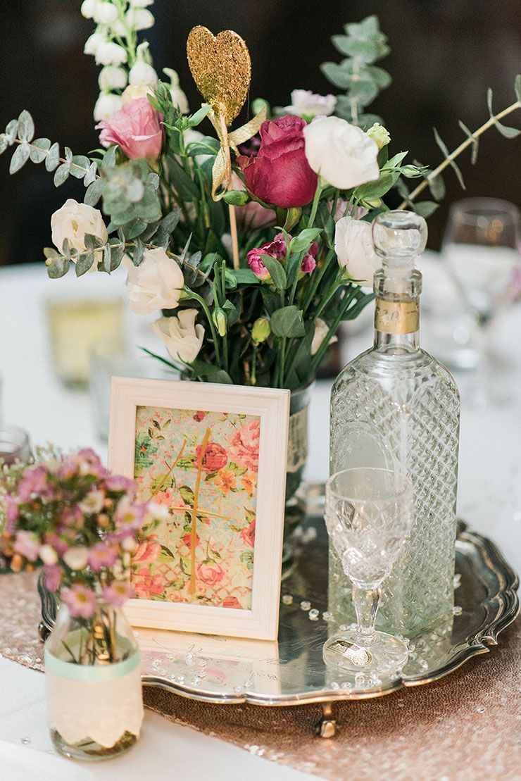 A romantic gold and pink vintage wedding framed table