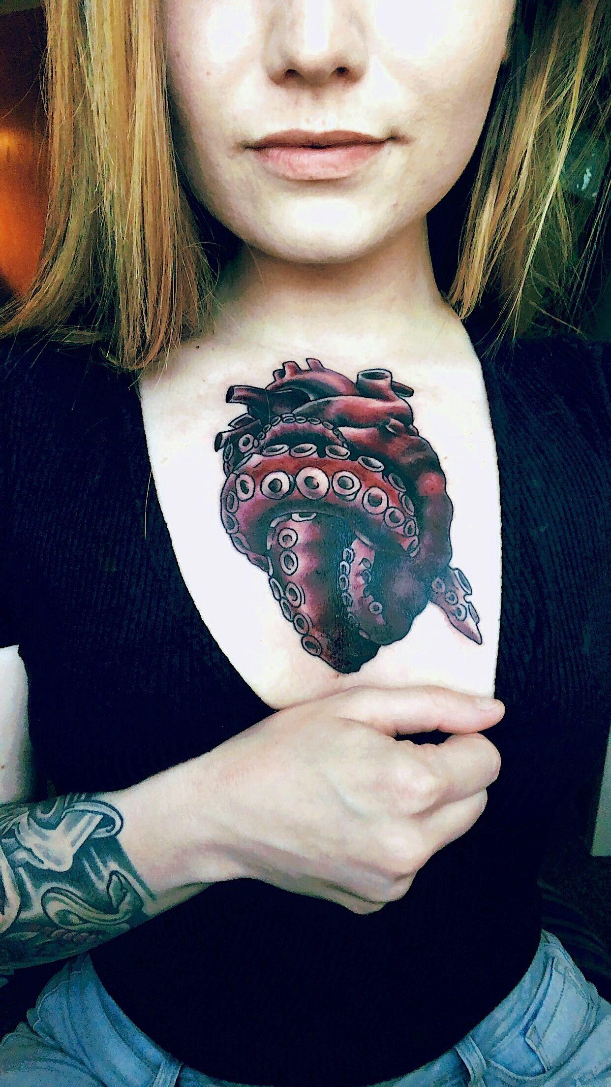 Octopus heart chest tattoo., Chest heart Octopus