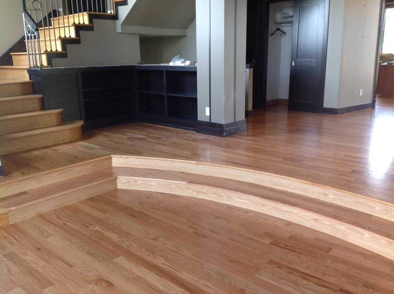 Red Oak curved stairs that we installed. Bamboo flooring