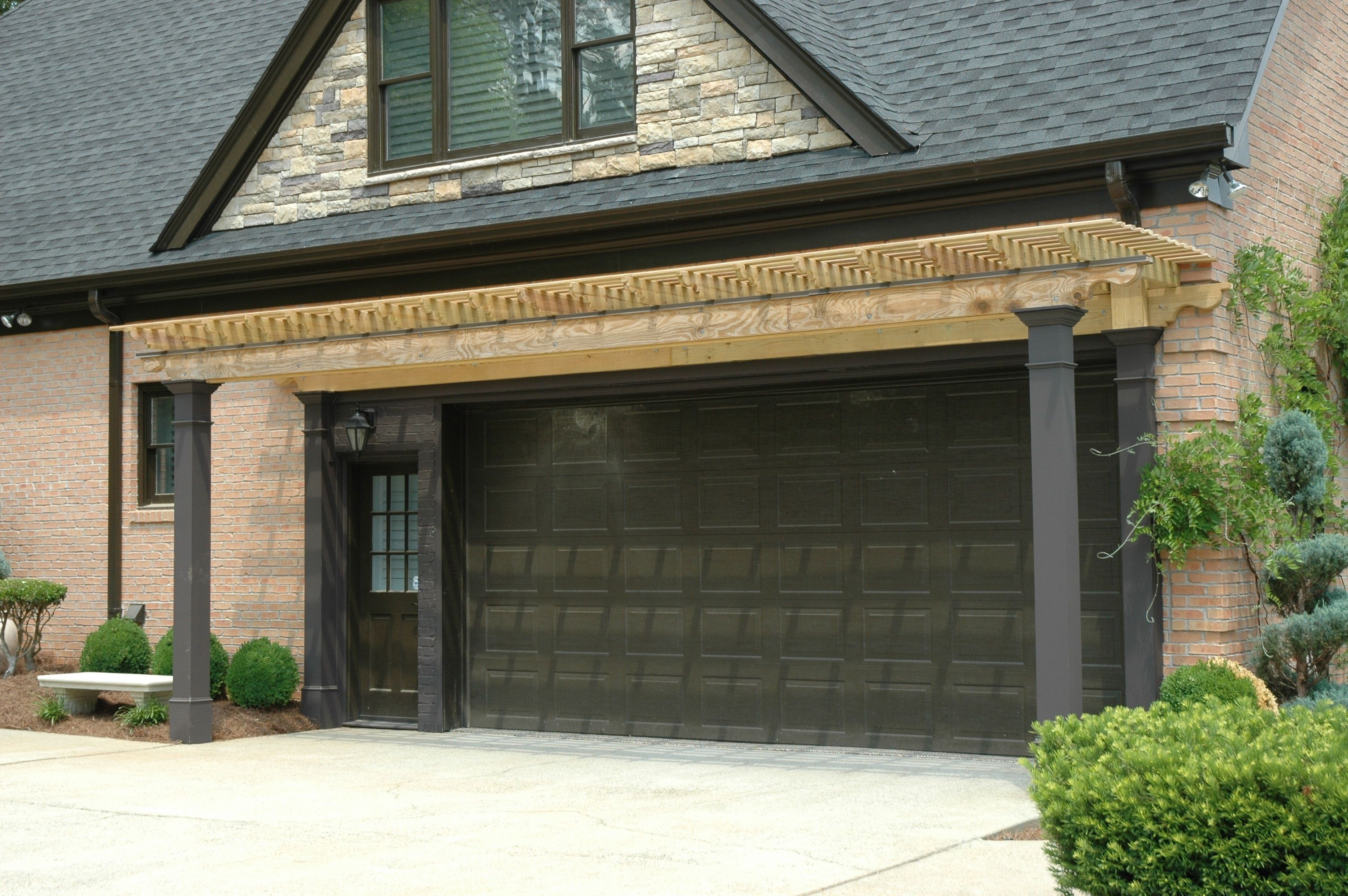 Wood Arbor Garage Overhang Designed And Built By Georgia Front Porch Garage Arbor Carriage Style Garage Doors Portico