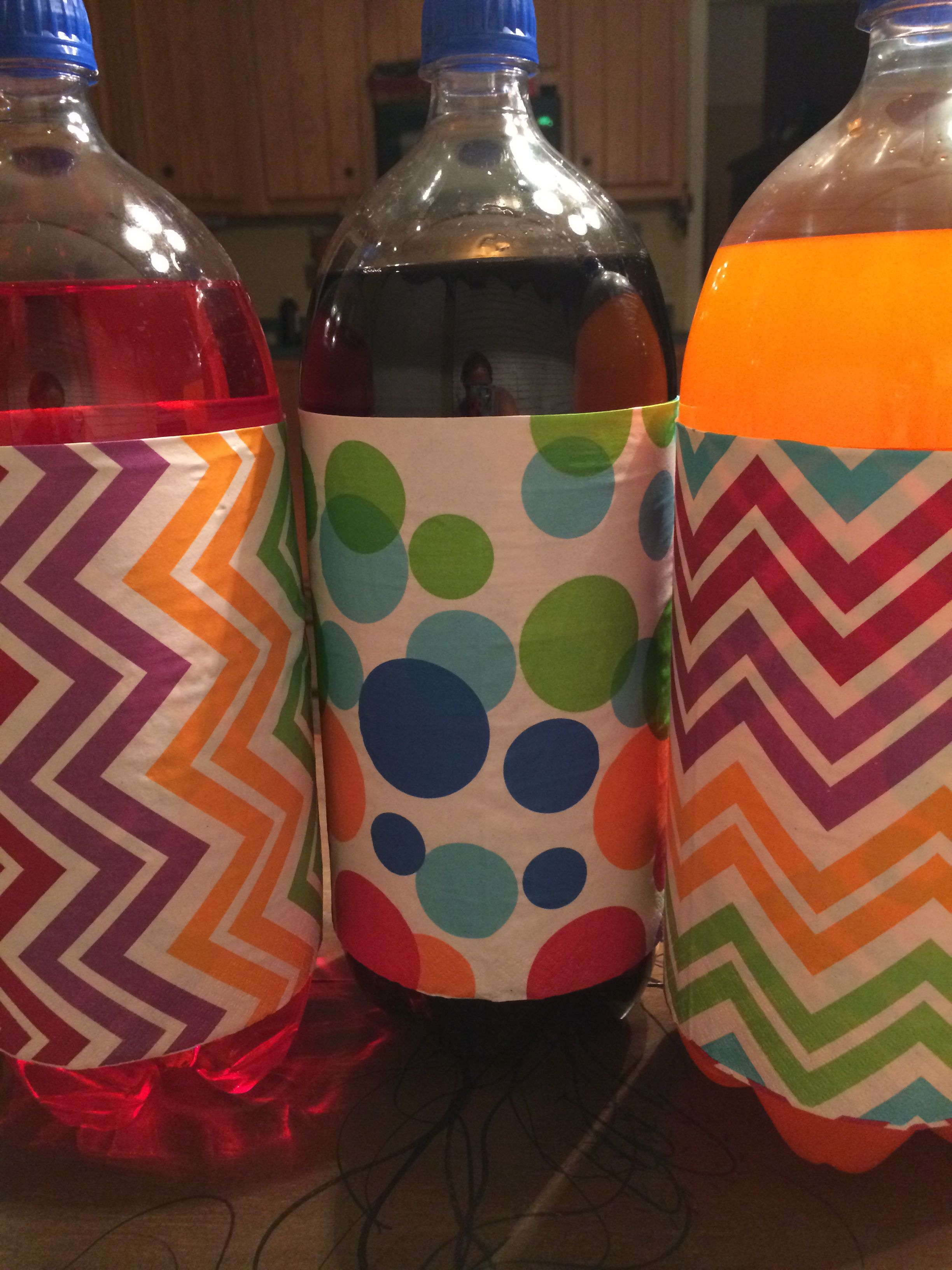 Cover up ugly pop bottles to match your party with party napkins!