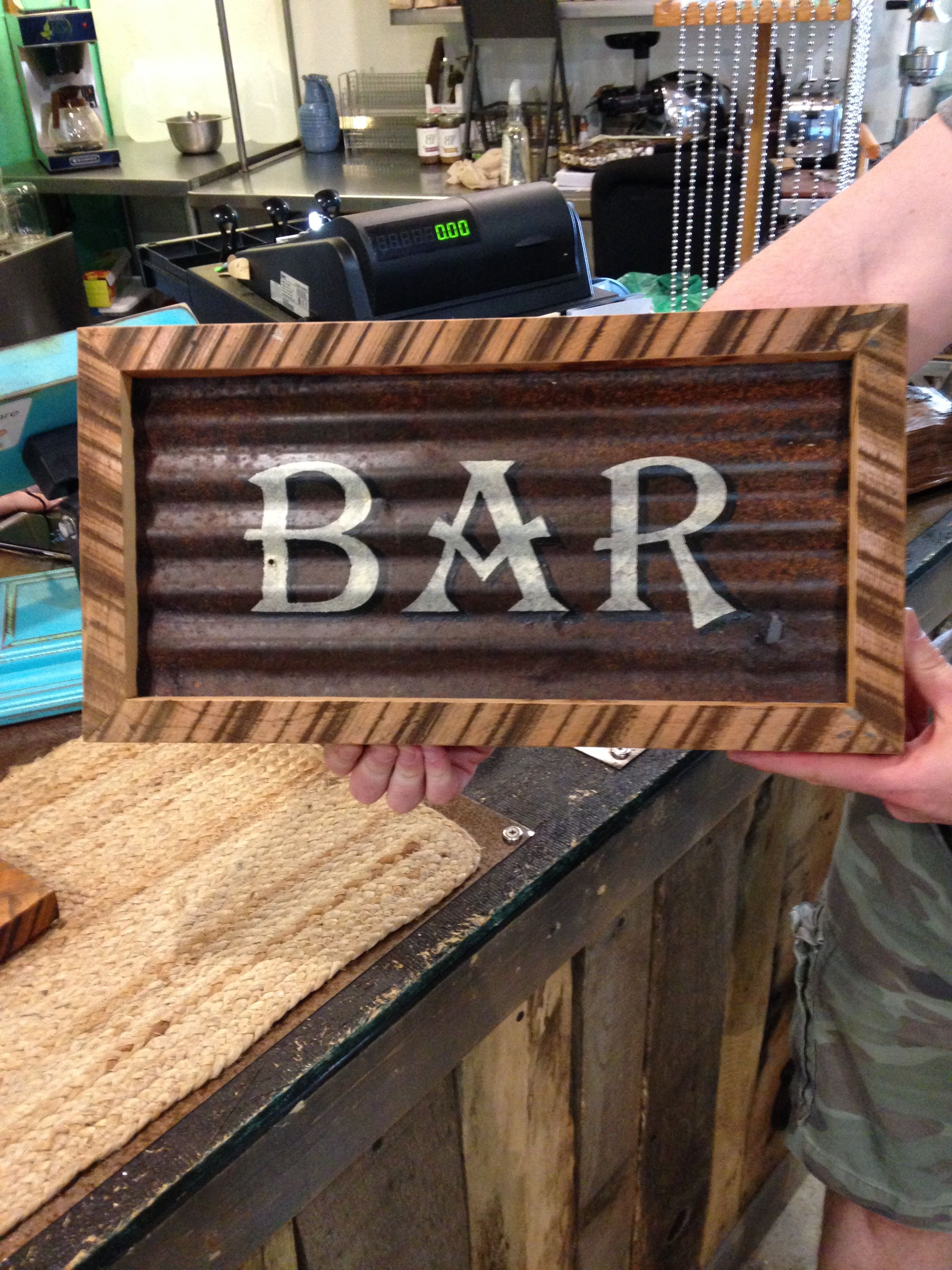 A small painted Bar sign made from reclaimed corrugated roofing and