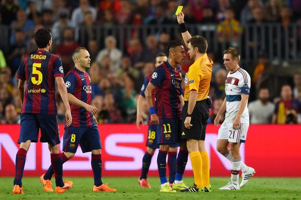 Neymar of Barcelona squares up to Referee Nicola Rizzoli of Italy as he is shown the yellow card during the UEFA Champions League Semi Final, first leg match between FC Barcelona and FC Bayern München at Camp Nou on May 6, 2015 in Barcelona, Catalonia.