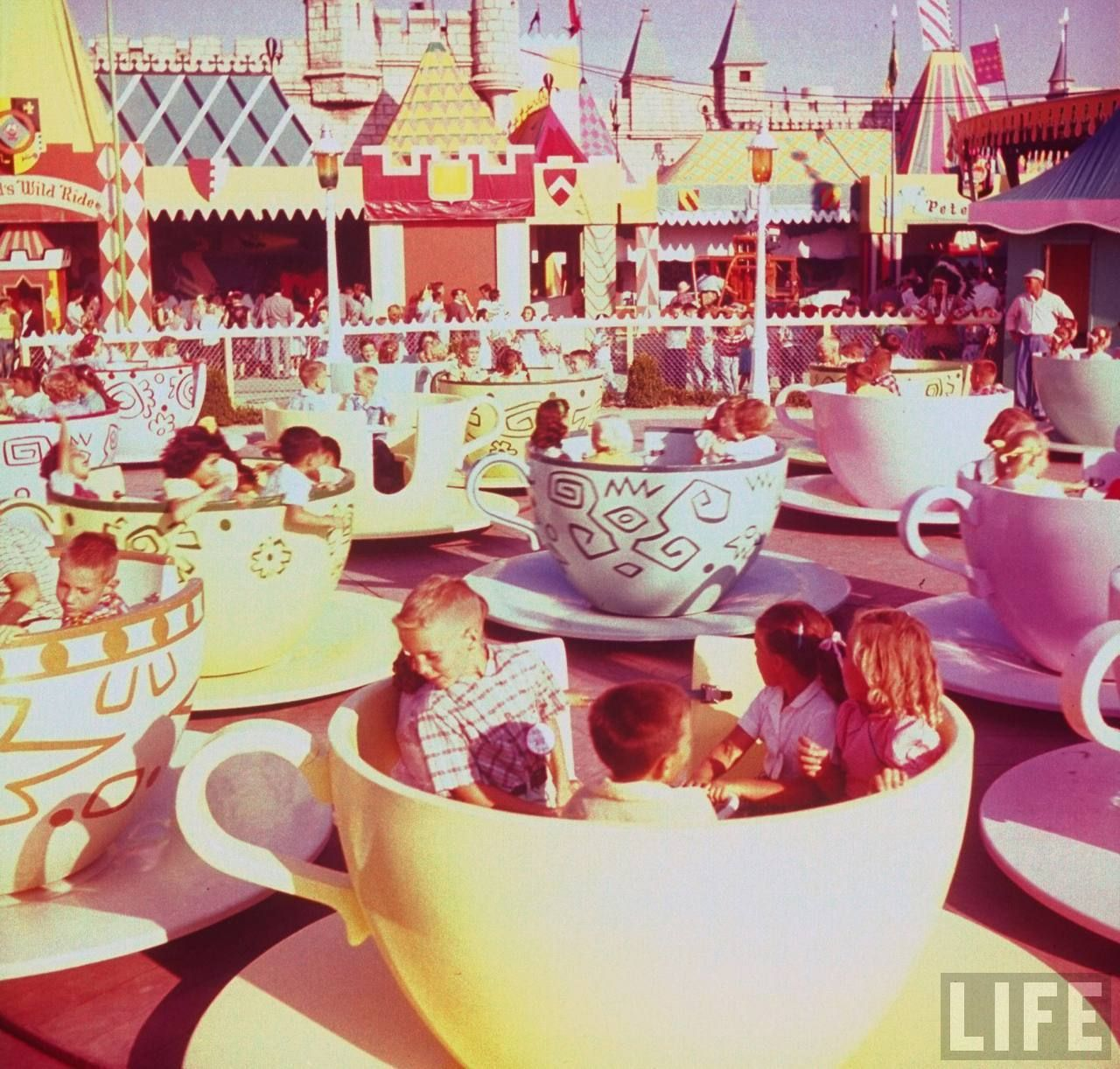 Tea cups circa 1950's, so magical. Also, amazing colors (that have not seen the likes of hipstamatic or instagram)! #disney