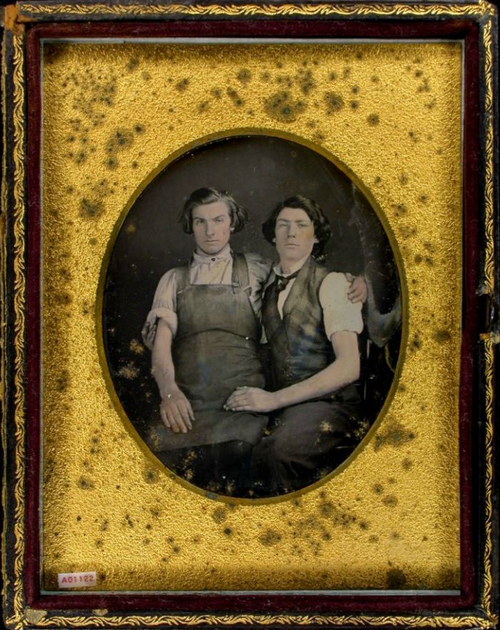 ca. 1850's, [daguerreotype portrait of two gentlemen; one in a work shop apron sitting on the lap of another wearing plaid vest] via t...