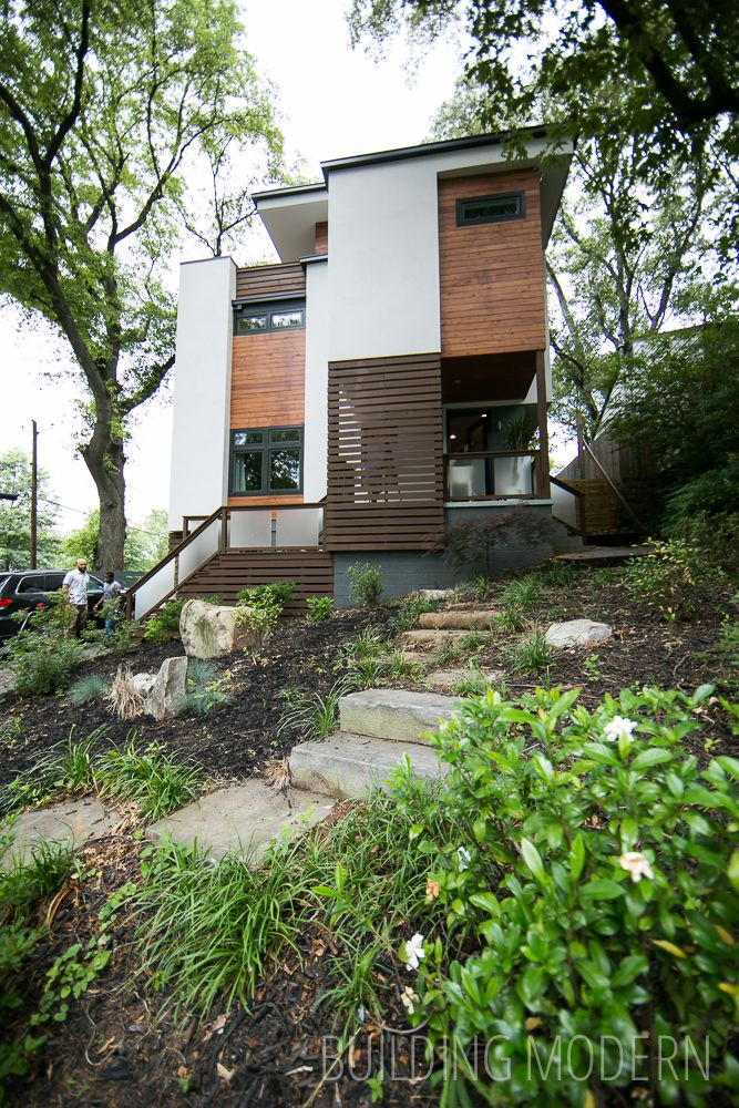 Modern Atlanta Home Tour 2014: Sanders Residence. XMETRICAL LLC architect. 4 bed, 4 bath home. White stucco and wood accent modern home exterior. Original home was featured on HGTV Curb Appeal The Block.