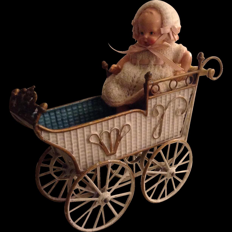 Beautiful antique metal tin dolls pram or carriage by