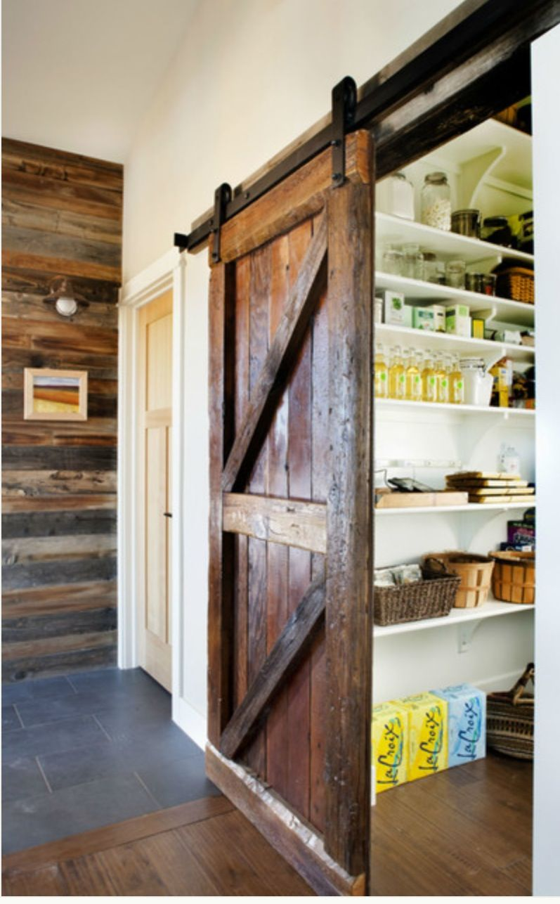 I love sliding barn doors in a mountain home they are space savers