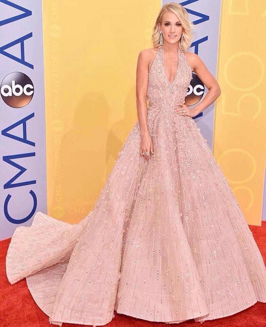 CARRIE UNDERWOOD wearing a couture fully beaded MICHAEL CINCO gown ...