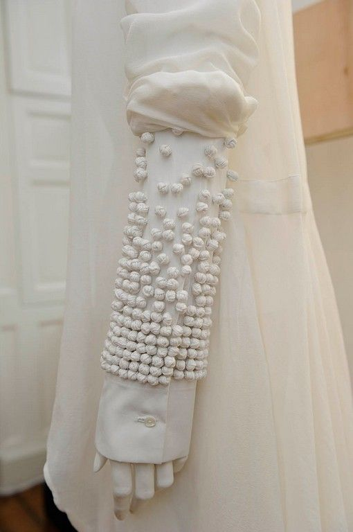 Shirt detail we love... knotted embellishment for decorative 3D textures; fabric manipulation // Palmer-Harding
