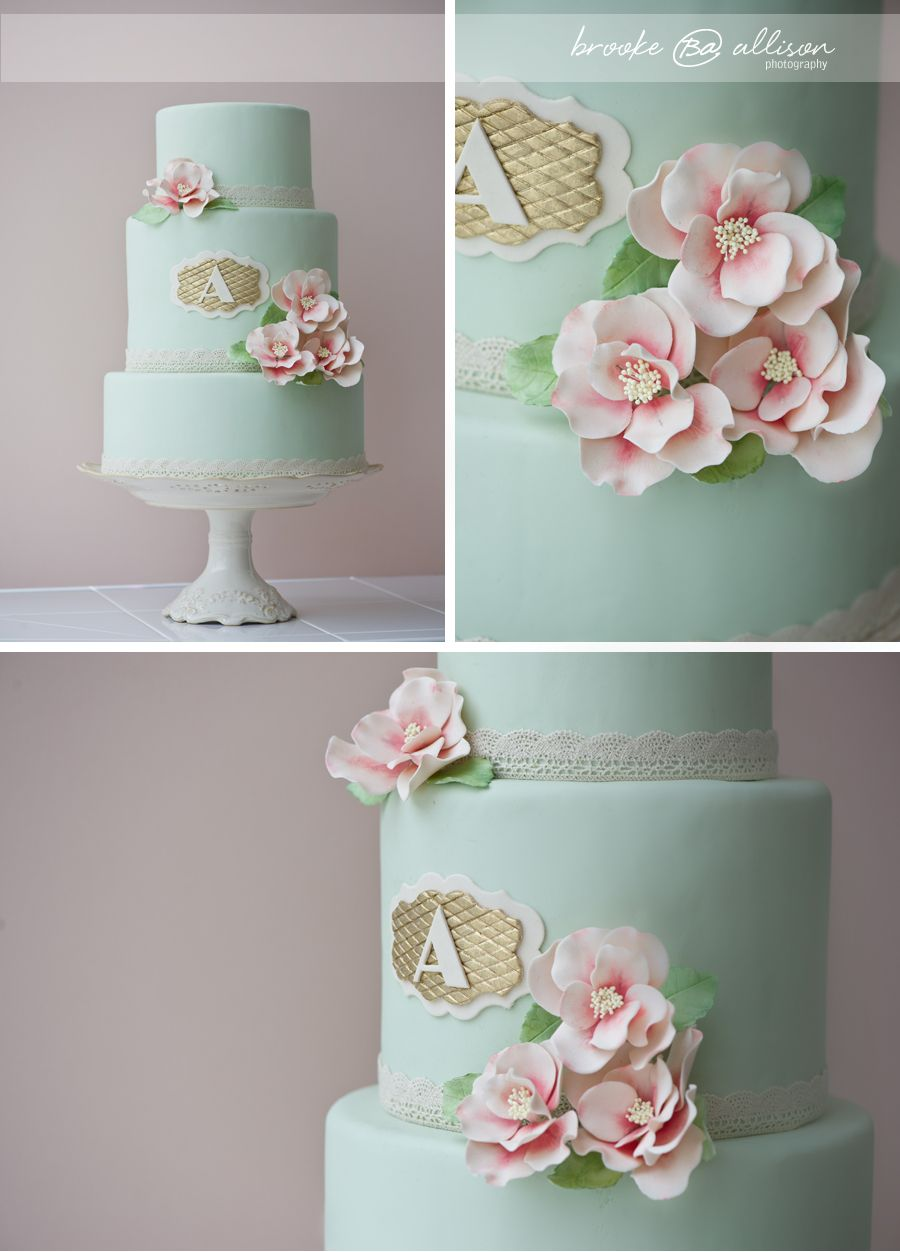 mint cake with monogram lace and pink flowers erica obrien cake design