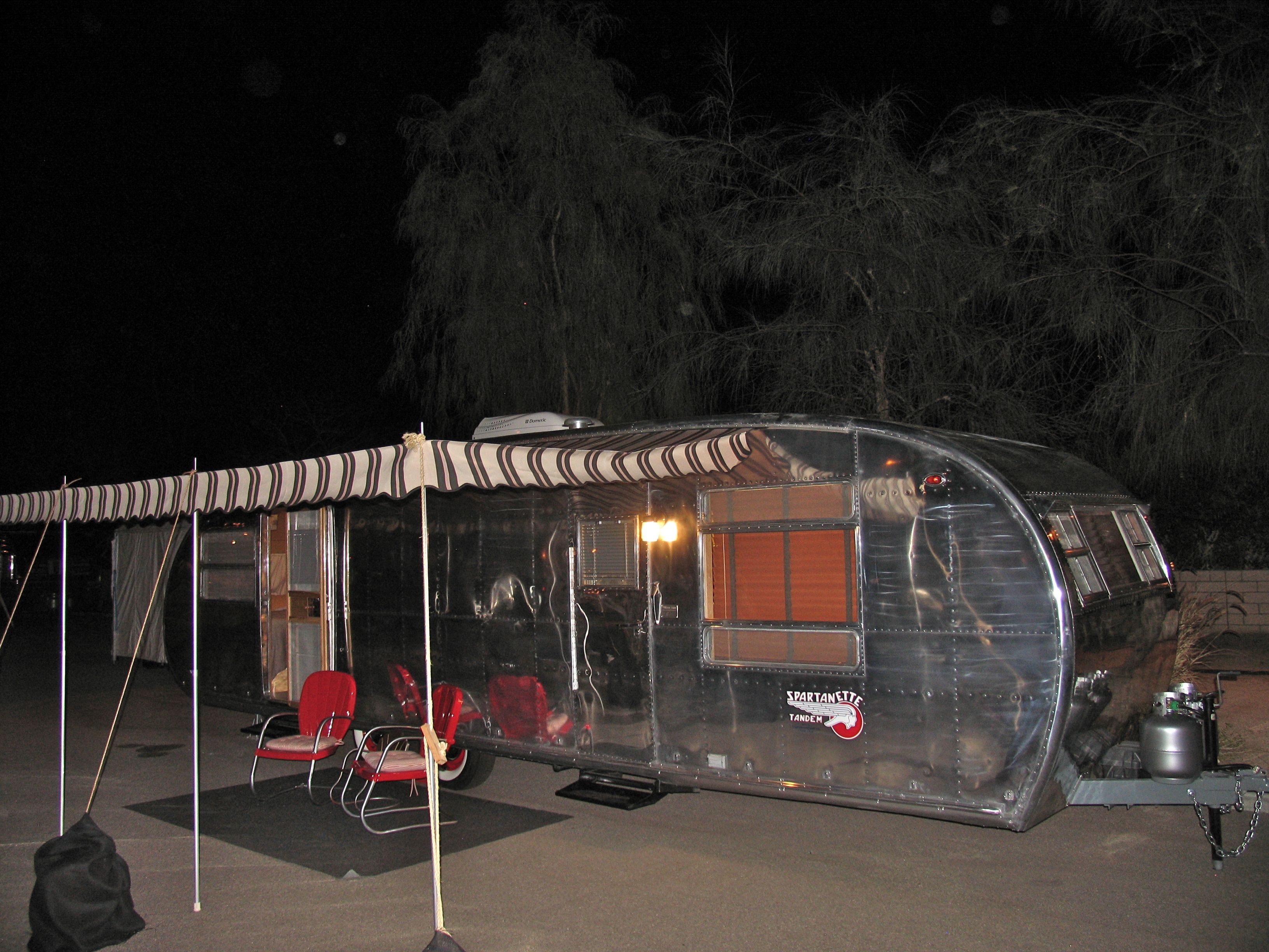 A Shiny Polished Exterior And Striped Awning Return This 1953 Spartanette Tandem To Its Glo Vintage Trailers Restoration Vintage Travel Trailers Travel Trailer