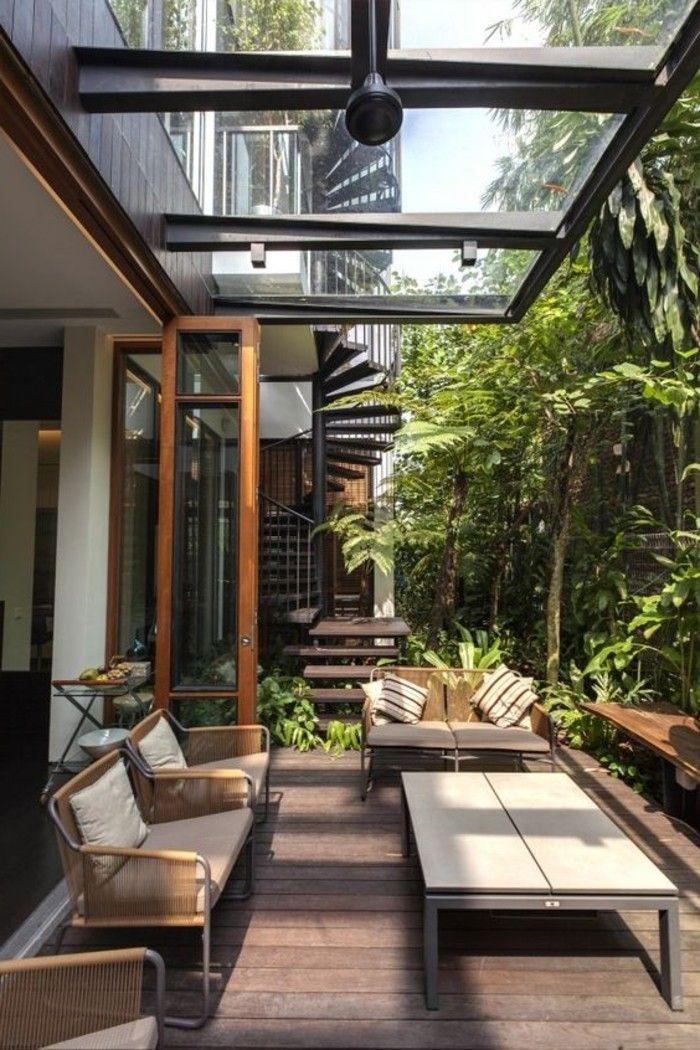 véranda-avec-verrière-de-toit-en-verre-comment-fenêtre-de-toit-velux - maison avec toit en verre