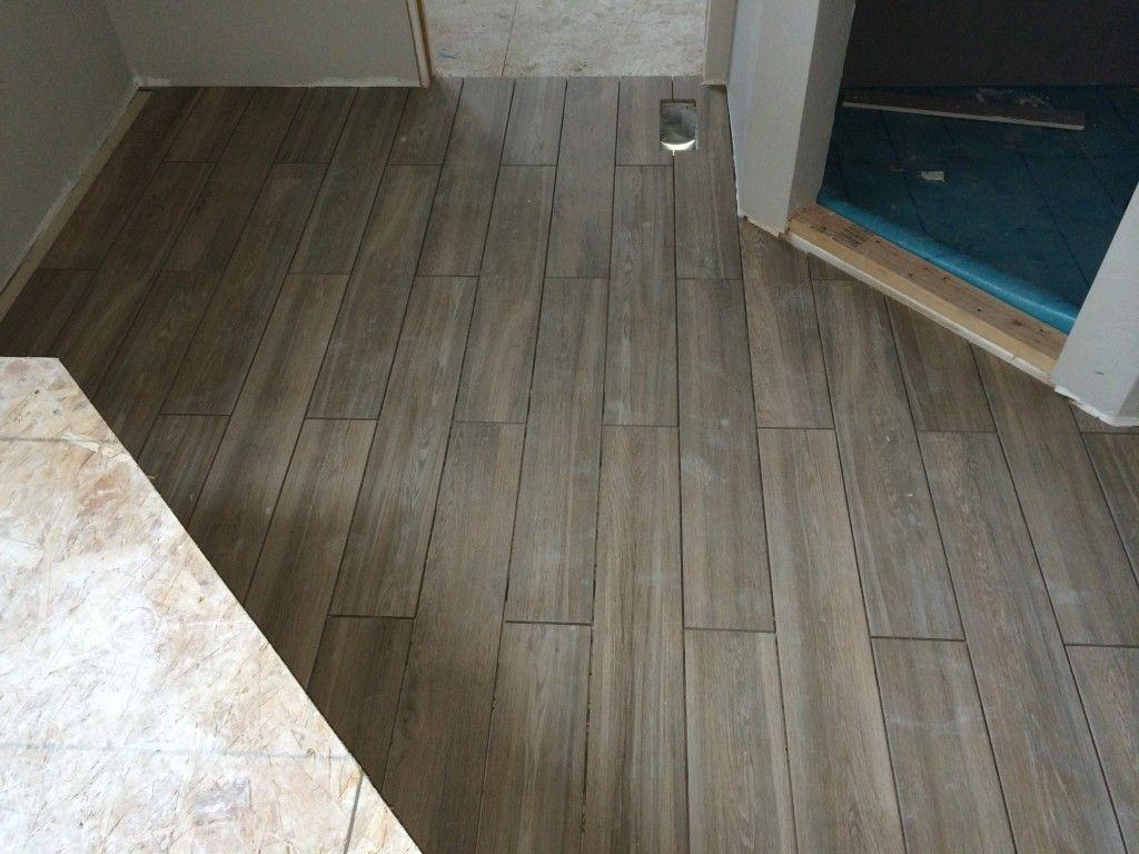 whitewashed ceramic wood tile floor in the bathroom  wood