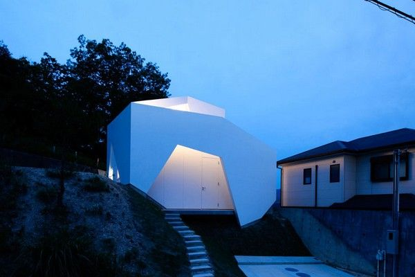 Asymmetrical Shaped Home With A Well Adjusted Architecture In