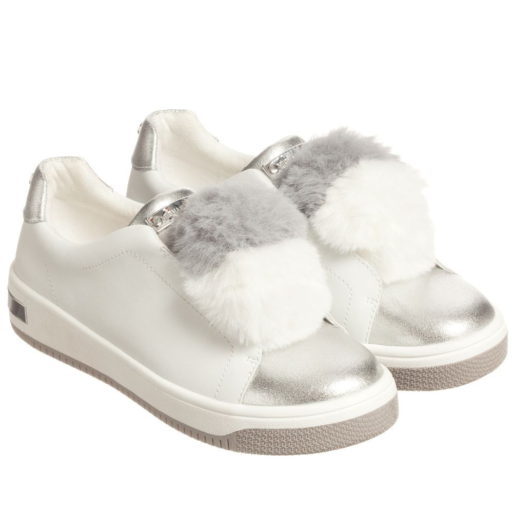 352bea0d61f0 Girls will love these sports luxe pom-pom sneakers from Michael Kors in  white and silver.