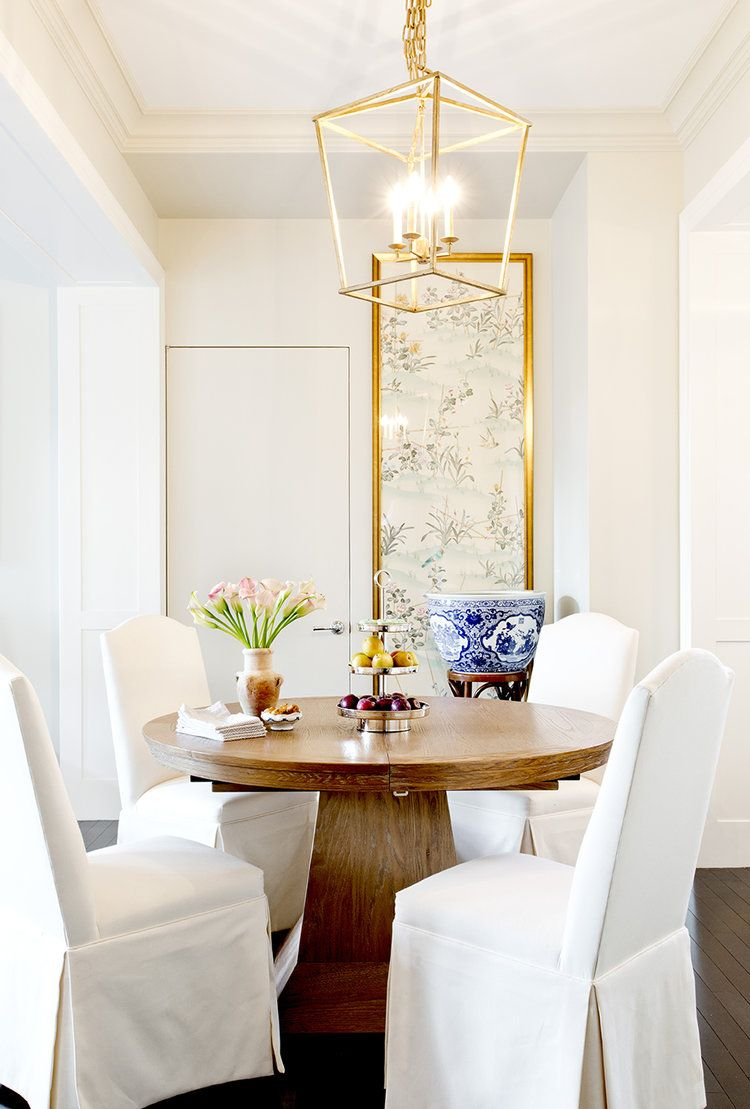 Wooden Circular Dining Table With Plush White Linen Chairs And Gold Hanging  Lantern Light Fixture | Good Looking
