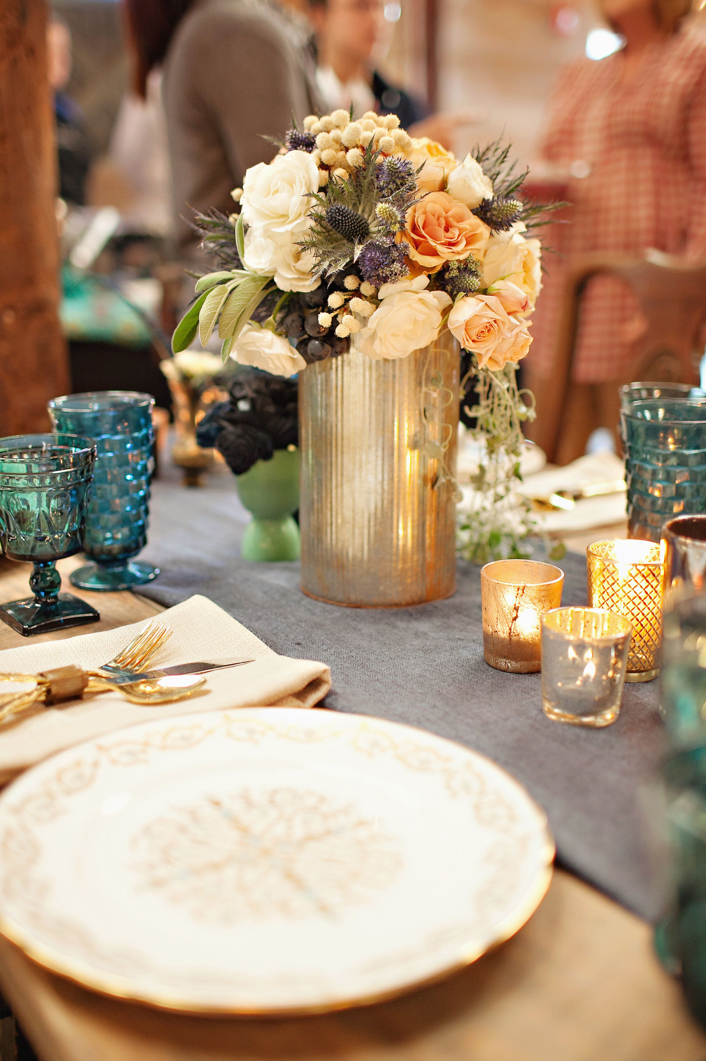 Steam punk flare mixed with vintage china for a unique wedding reception or event table setting-  styled by Jennifer Hopkins with Virtu Floral and Event Design with Southern Vintage china, stemware and gold flatware. Vinewood Weddings and Events. Paperlily Photography
