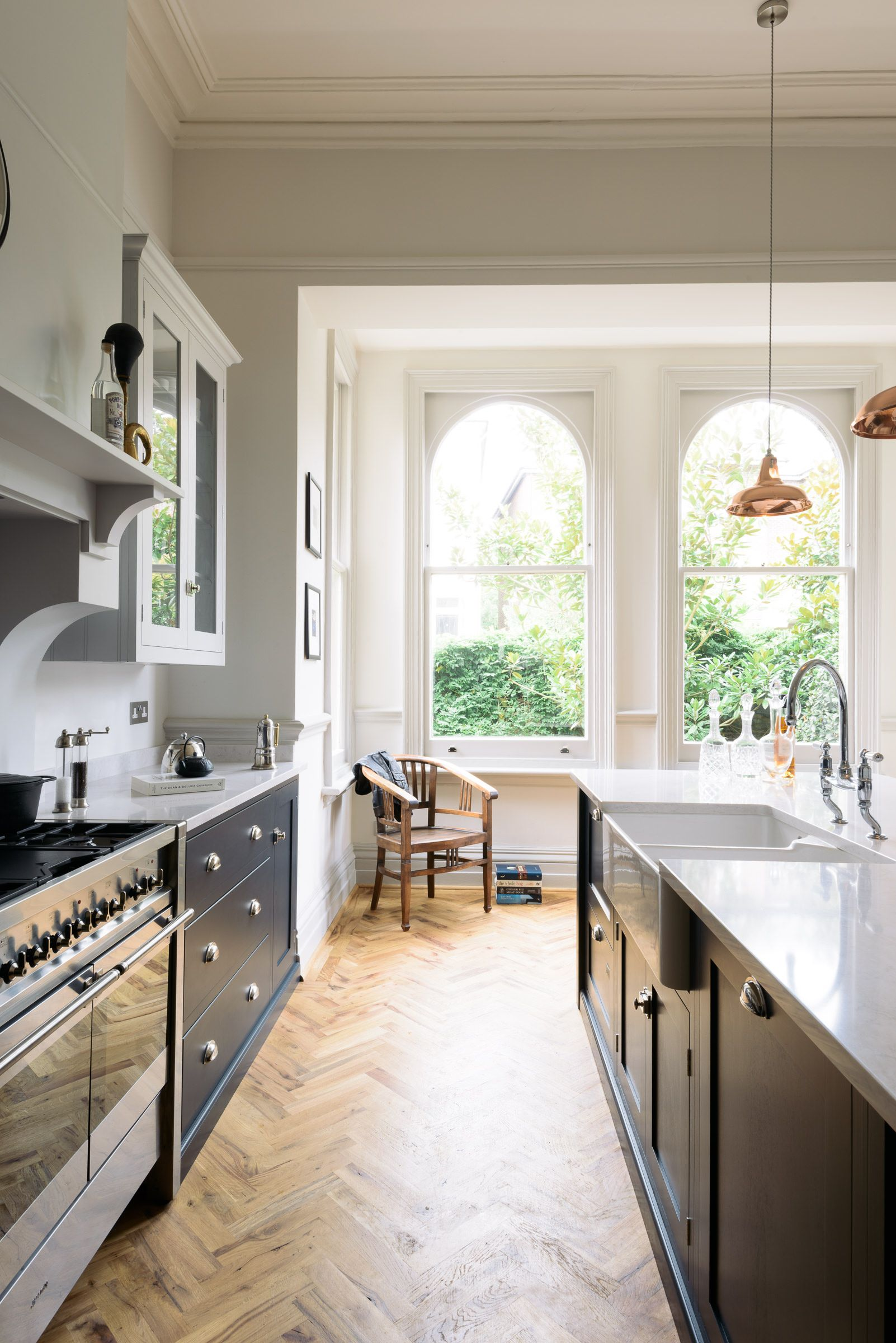 Huge original arched windows fill this family kitchen with light ...