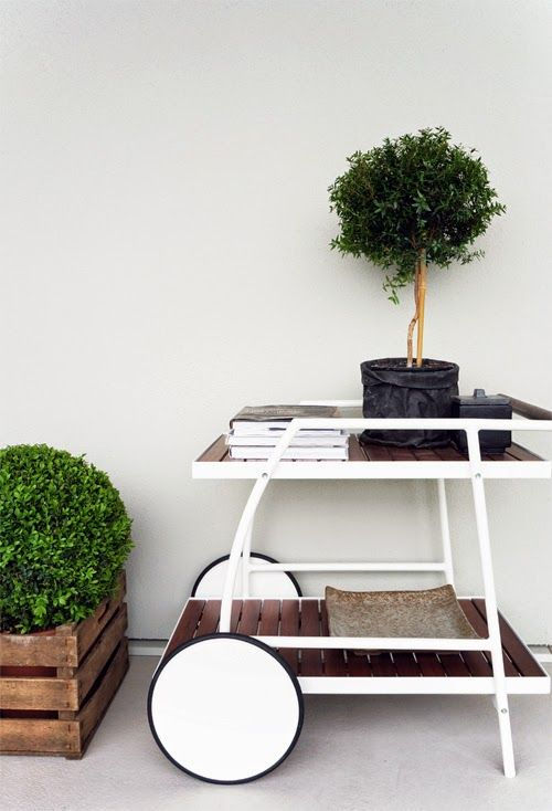 Mix it up - potted plants on a bar cart, why not?