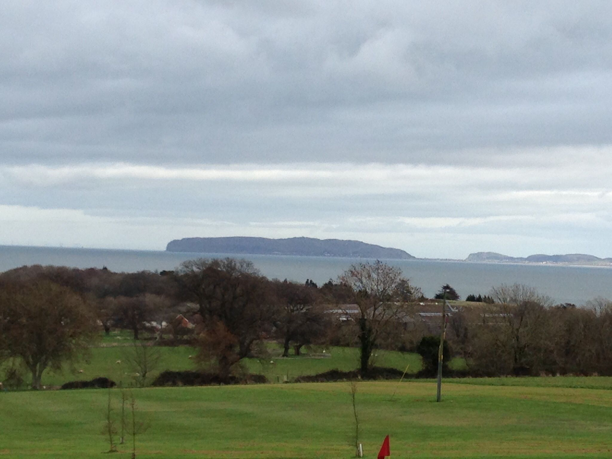 Henllys Golf Course.  Played with Ralph 19/3/14. Pretty course, with views of Menai Straits and Snowdonia. Some long walks between green and tee. Watch out for ditches and ponds.