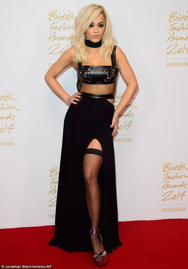 af0d0036c5fc4 Super sexy: Rita Ora displayed her svelte shape in a seductive black gown  as she arrived at The British Fashion Awards 2014 in London on Monday