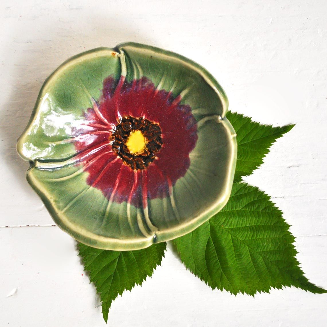 Ceramic Poppy spoon rest tea bag holder handmade  Celadon Green and Red. $13.00, via Etsy.