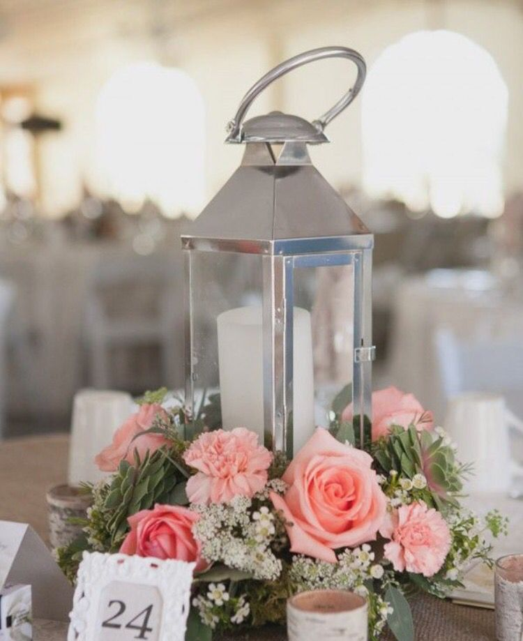 Pin by heydi orellana on jazmines 15 pinterest centerpieces white flowers instead of pink romantic lantern roses centerpiece junglespirit Image collections
