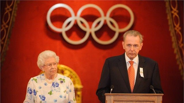 Queen Elizabeth II and Jacques Rogge, President of the International Olympic Committee (IOC), at a reception for members of the IOCat Buckingham Palace on 23 July 2012.