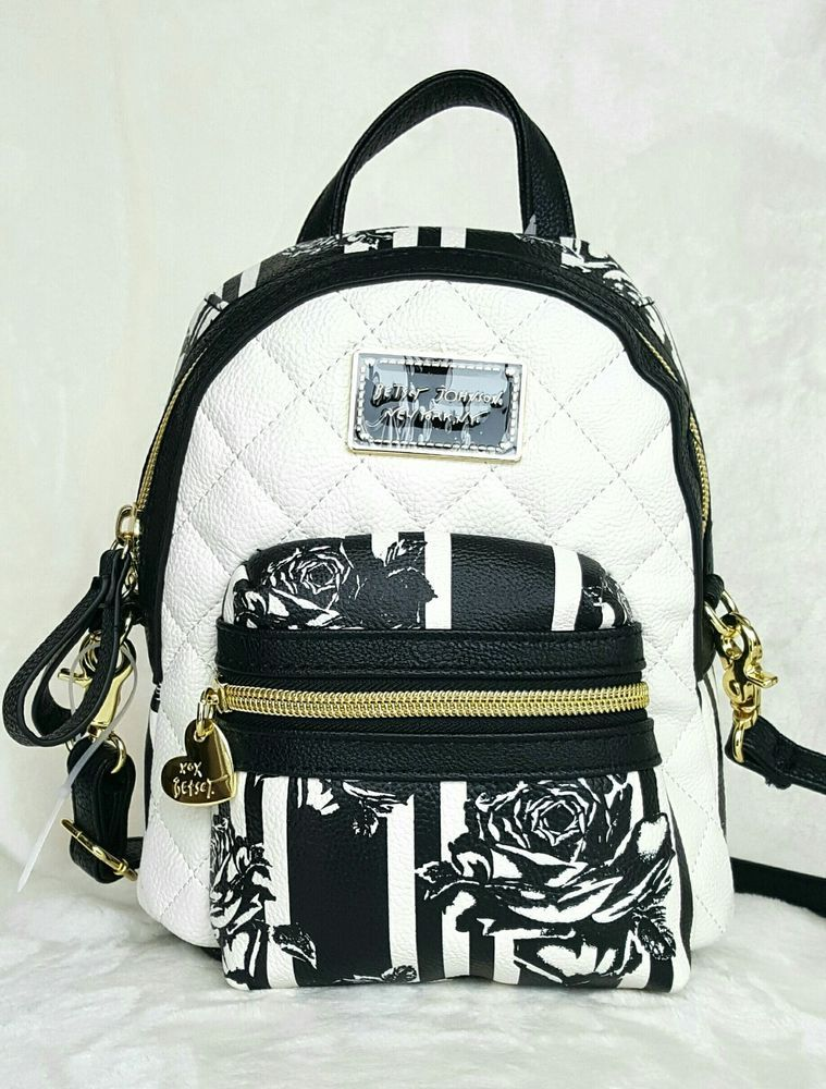 a7201762cc Betsey Johnson Mini Convertible Crossbody Backpack - FLORAL  BetseyJohnson   BackpackStyle. Find this Pin and more on Purses ...